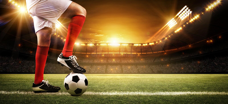 Fotbollsspelare på stadion fotografering för bildbyråer