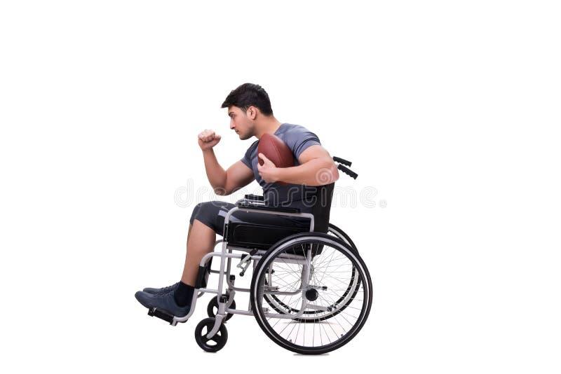 Fotbollsspelaren som återställer från skada på rullstolen royaltyfri foto