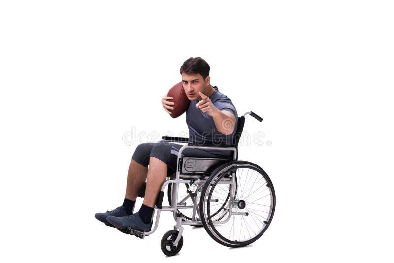 Fotbollsspelaren som återställer från skada på rullstolen royaltyfri bild