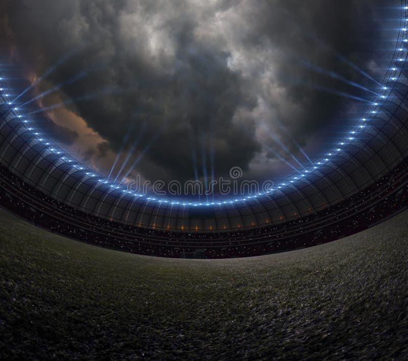 Fotbollstadion med belysning, natthimmel för grönt gräs royaltyfri fotografi