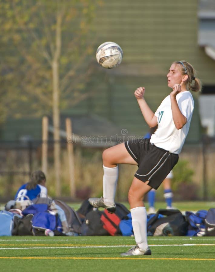 fotbolluniversitetar för 3 flickor arkivfoto
