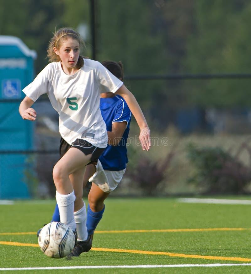 fotbolluniversitetar för flickor 5a royaltyfri fotografi