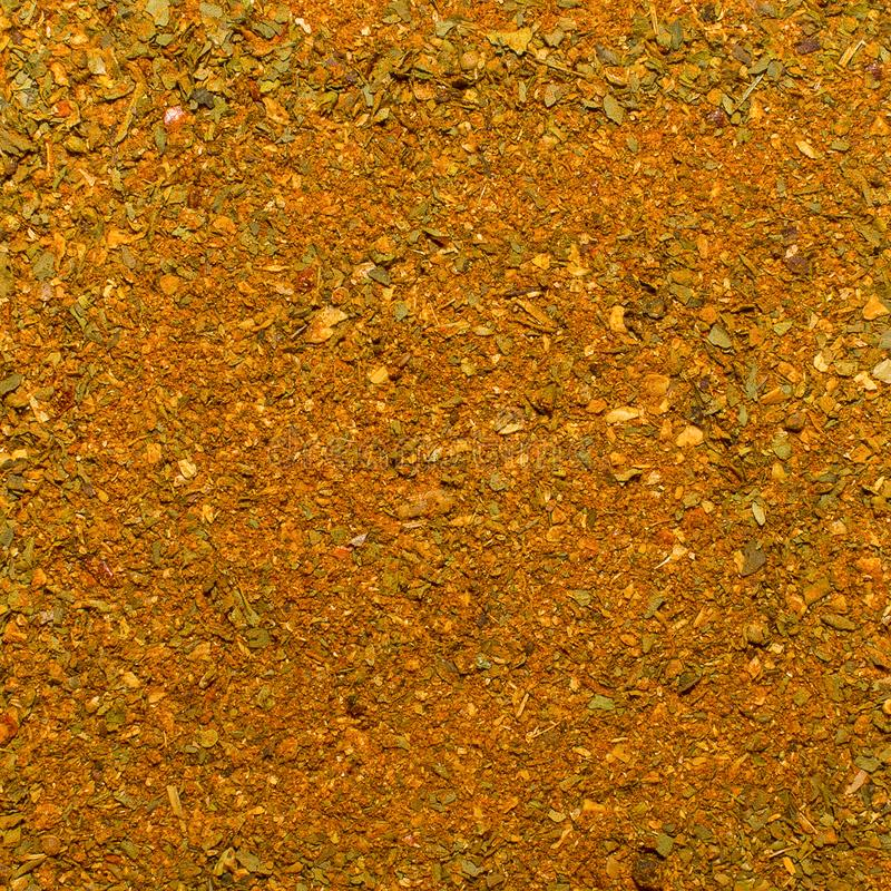 Foto av closeuptextur av den orange kryddan för kött och höna och annan mat, bakgrund arkivfoto