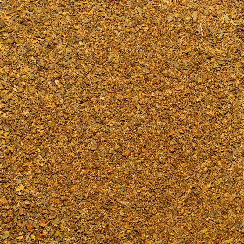 Foto av closeuptextur av den orange kryddan för kött och höna, bakgrund arkivfoton