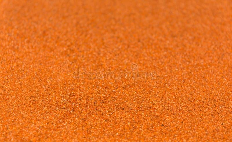 Foto av closeuptextur av den varma kryddan av röd peppar för olik mat, bakgrund arkivfoto