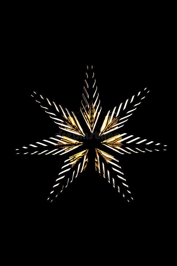 Foto av en guld- stjärna med ljusa kulor fotografering för bildbyråer