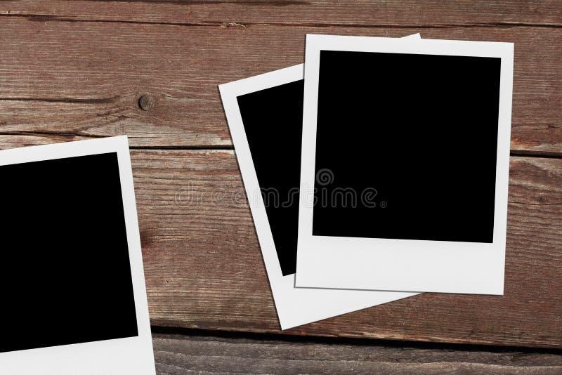Foto in bianco del polaroid Strutture d'annata sul legno immagini stock libere da diritti