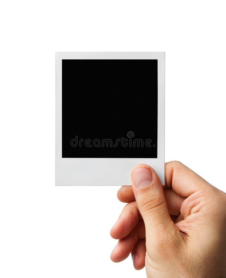 Foto in bianco in mano umana con il percorso di residuo della potatura meccanica fotografia stock libera da diritti