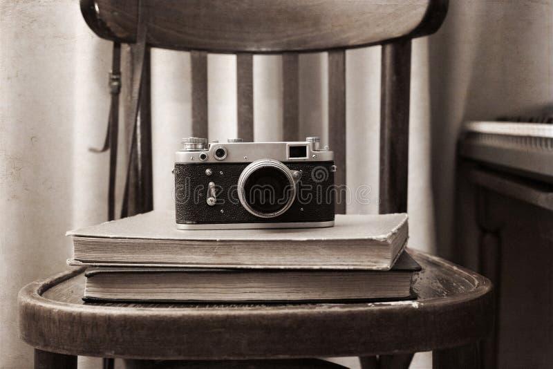Foto-cámara, libros imagen de archivo libre de regalías