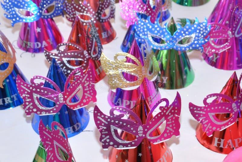 Foto colorida de la máscara de ojo de los casquillos de los mejores de cumpleaños niños de la fiesta foto de archivo
