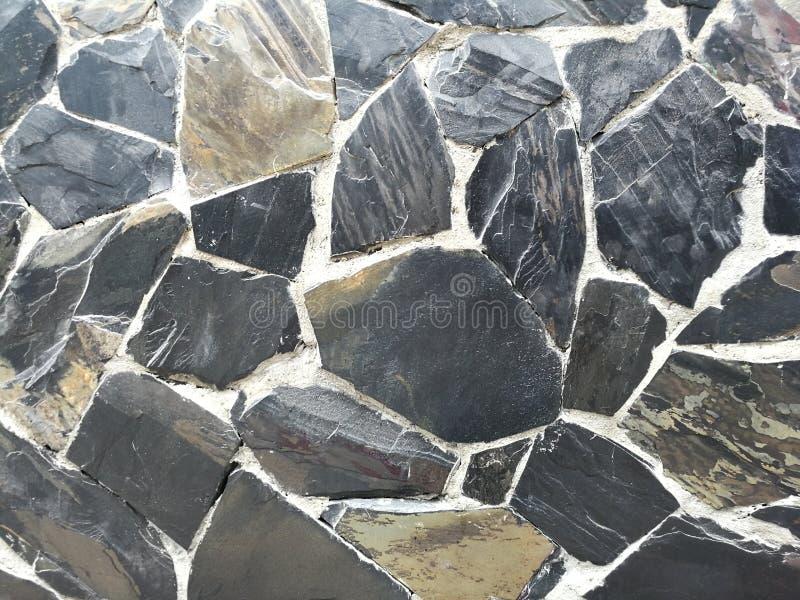 Foto común del fondo superficial de la pared de piedra de la roca fotos de archivo
