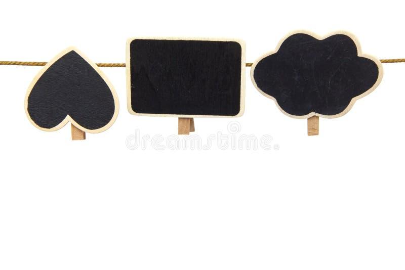 Foto común - pedazo rasgado de ejecución del tablero de tarjeta en un clothesp fotografía de archivo