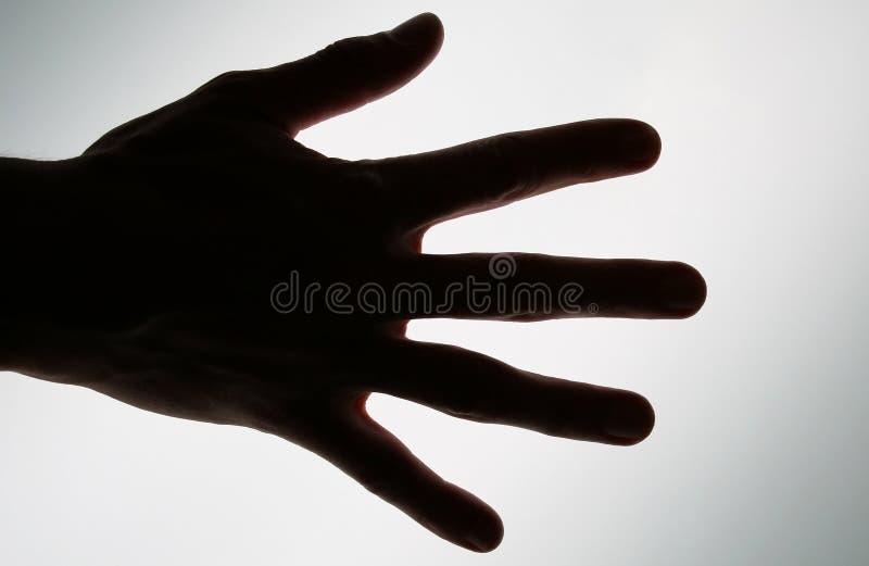 Foto concettuale di una mano pronta a catturare o realizzare fotografia stock