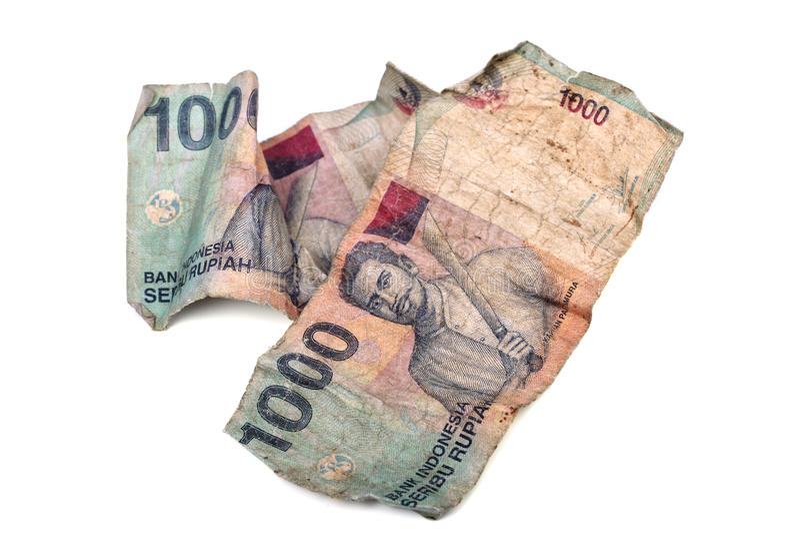 Foto concettuale di vecchia rupia indonesiana sgualcita sporca fotografie stock libere da diritti