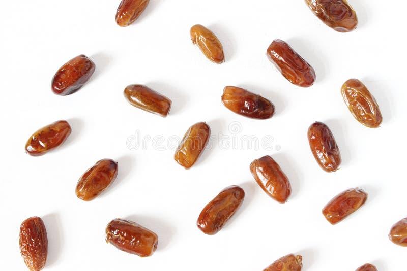 Foto conservada em estoque denominada Composição do desktop da ramadã com fruto da data no fundo branco Teste padrão do alimento  imagens de stock