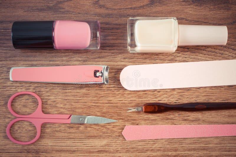 Foto, cosméticos e acessórios do vintage para o tratamento de mãos ou o pedicure, imagem de stock