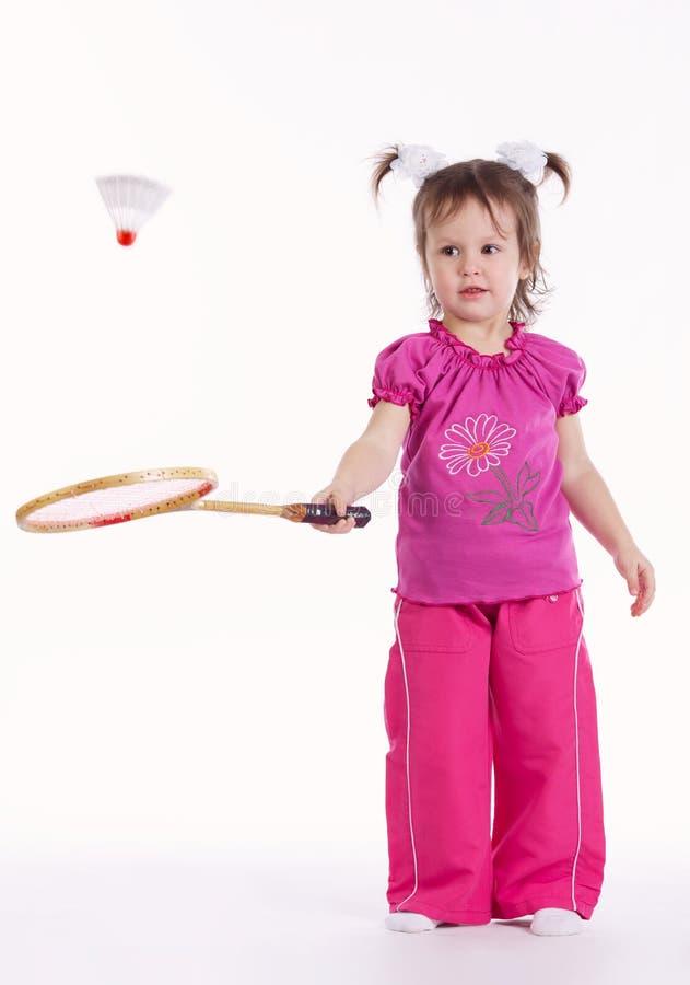 Foto da menina que joga o badminton fotografia de stock royalty free