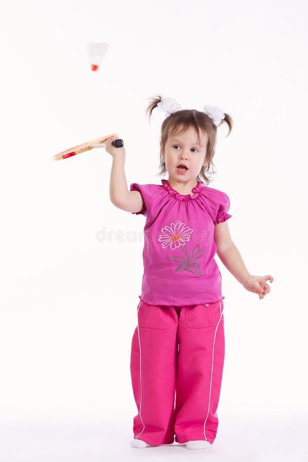 Foto da menina que joga o badminton imagens de stock