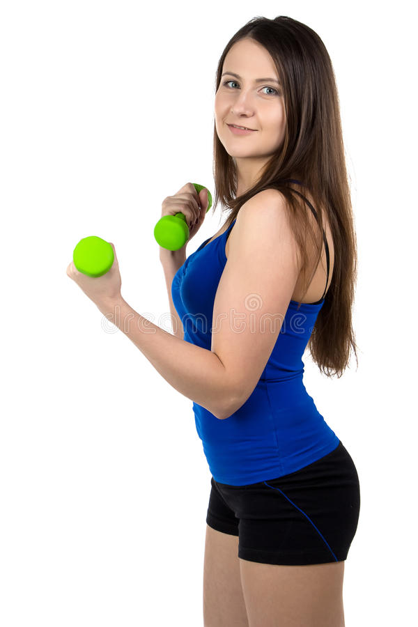 Foto da mulher desportiva com pesos foto de stock