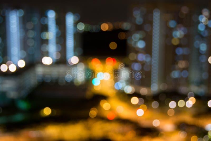 Foto da skyline da noite com borrão e efeito de Bokeh imagens de stock