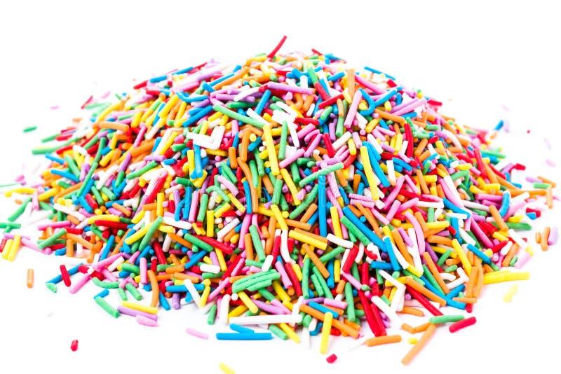 A foto de doces coloridos polvilha isolado no fundo branco imagem de stock royalty free