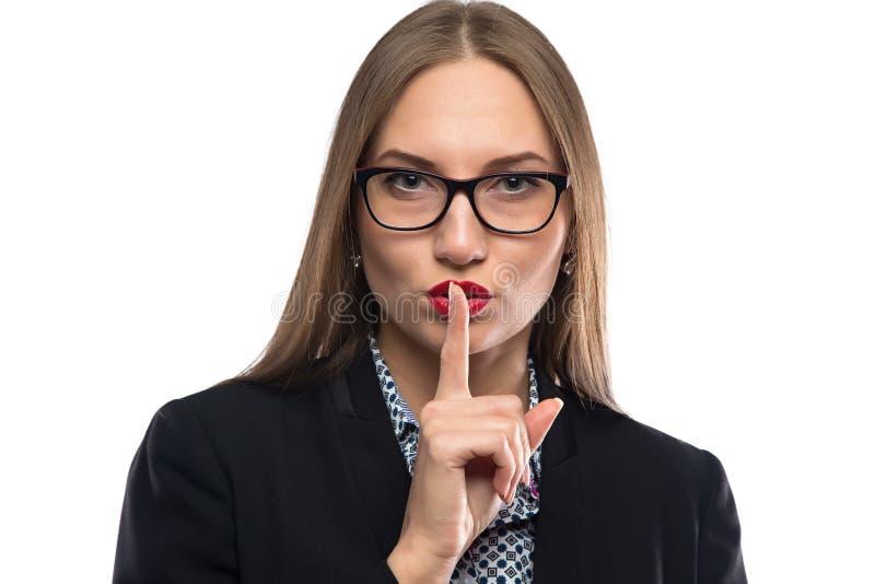 Foto de la empresaria que muestra silencio en vidrios fotos de archivo libres de regalías
