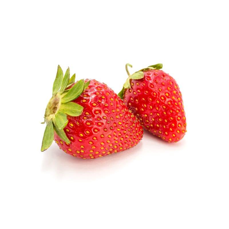Foto de la fresa roja aislada en el fondo blanco fotos de archivo