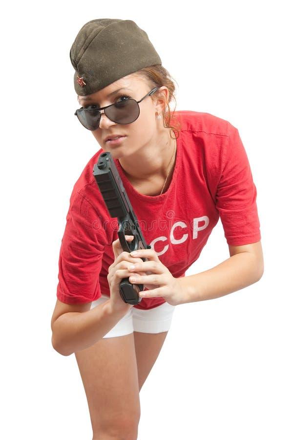 Foto de la muchacha en arma de la explotación agrícola del casquillo de ultramar fotos de archivo libres de regalías