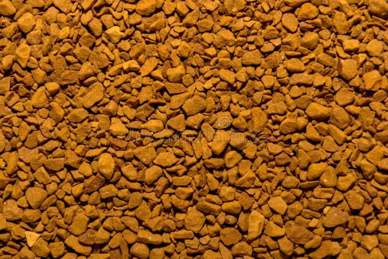 Foto de la textura del primer del café instantáneo molido marrón, fondo imágenes de archivo libres de regalías