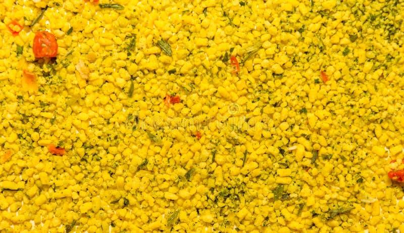Foto de la textura del primer de la especia amarilla universal para diversa comida, fondo fotos de archivo libres de regalías