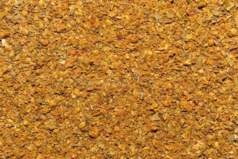 Foto de la textura del primer de la especia anaranjada para la carne y el pollo, fondo foto de archivo