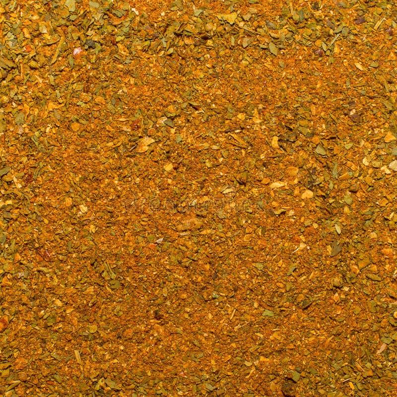 Foto de la textura del primer de la especia anaranjada para la carne y el pollo y la otra comida, fondo foto de archivo