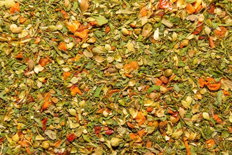 Foto de la textura del primer de la especia anaranjada para los platos y la otra comida, fondo de la guarnición fotografía de archivo
