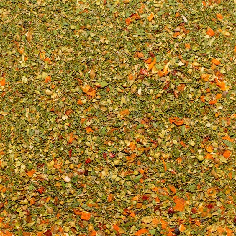 Foto de la textura del primer de la especia anaranjada para los platos y la otra comida, fondo de la guarnición fotografía de archivo libre de regalías