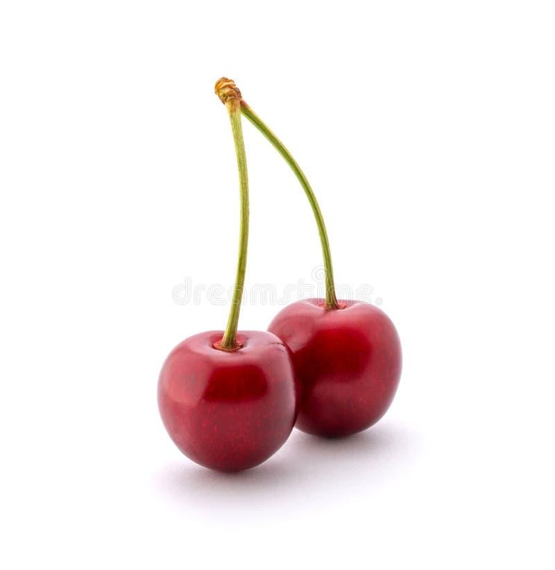 Foto de las cerezas rojas aisladas en el fondo blanco foto de archivo libre de regalías
