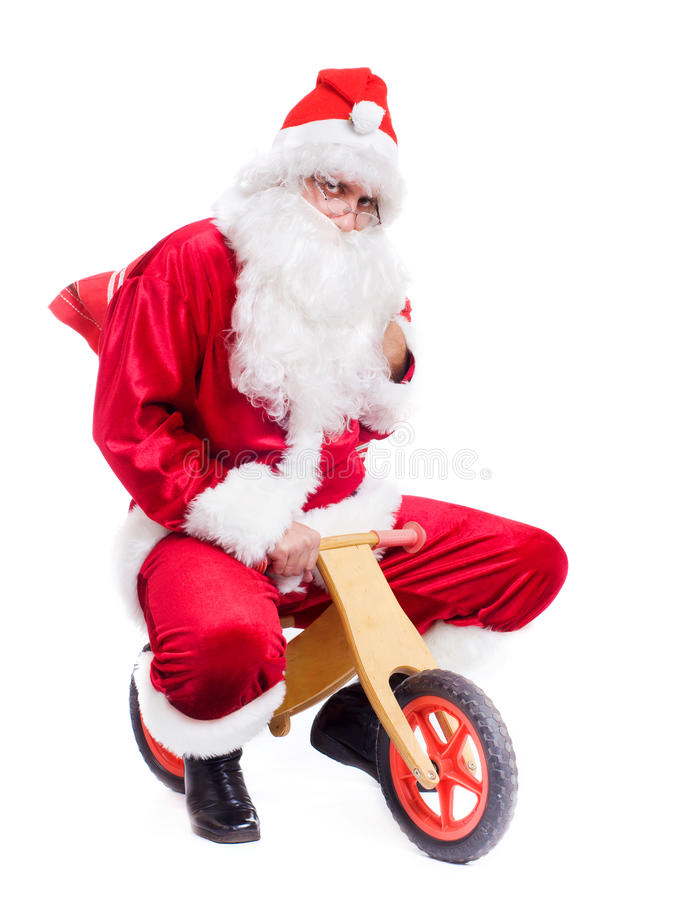 Foto de Papai Noel feliz na bicicleta foto de stock