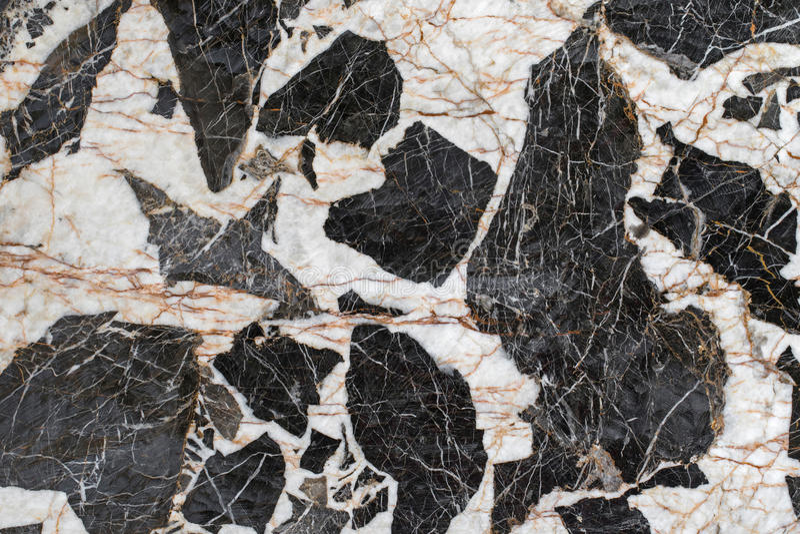 Foto de piedra de la textura del fondo de la roca de la pegmatita de la roca ígnea con bla fotografía de archivo