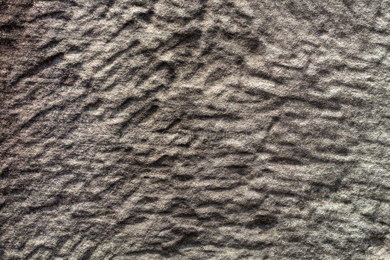 Foto de piedra pulida de la textura Fondo de piedra natural Alivio resistido de la roca Pared vieja de la piedra de construcción imagenes de archivo
