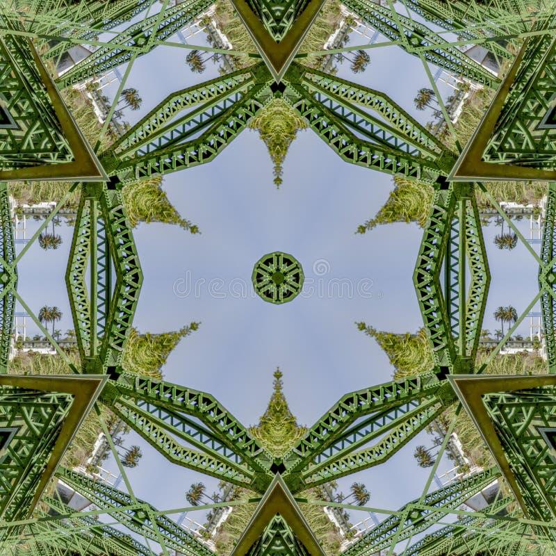 Foto de repetição simétrica criada de dobrar uma foto de uma ponte verde em Califórnia ilustração stock