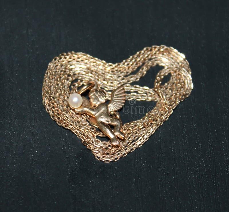 Foto de um anjo no meio do coração imagens de stock