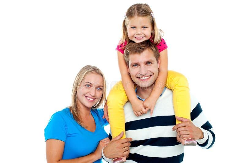 Foto de uma família alegre que aprecia fotos de stock royalty free