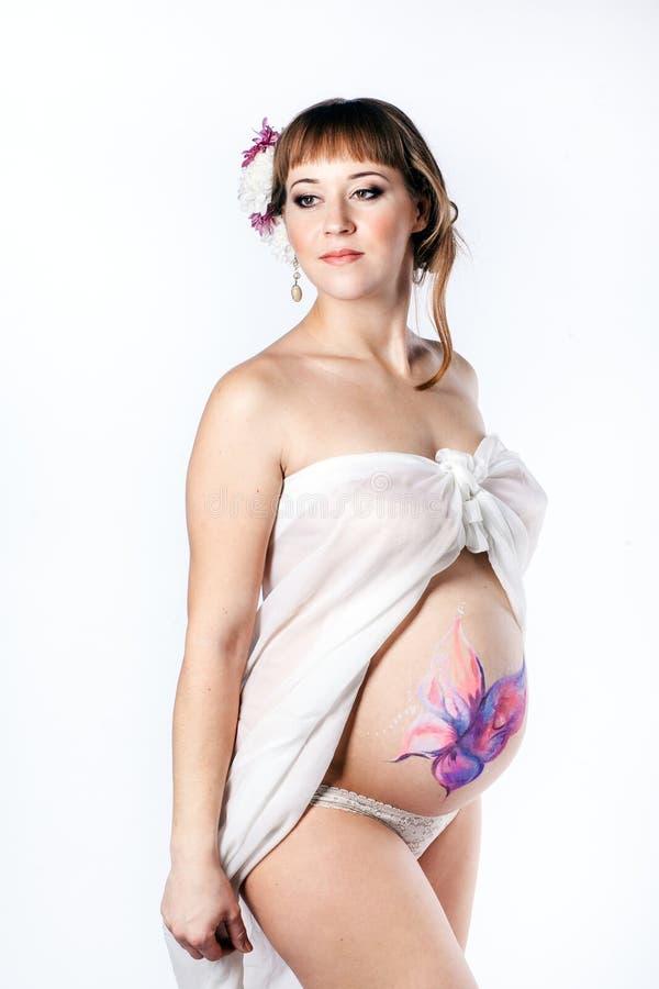 Foto de uma mulher gravida nova fotos de stock royalty free