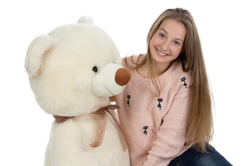 Foto del adolescente feliz con el oso de peluche imagenes de archivo