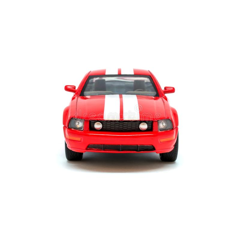 Foto del coche modelo del juguete rojo aislado en el fondo blanco fotografía de archivo libre de regalías
