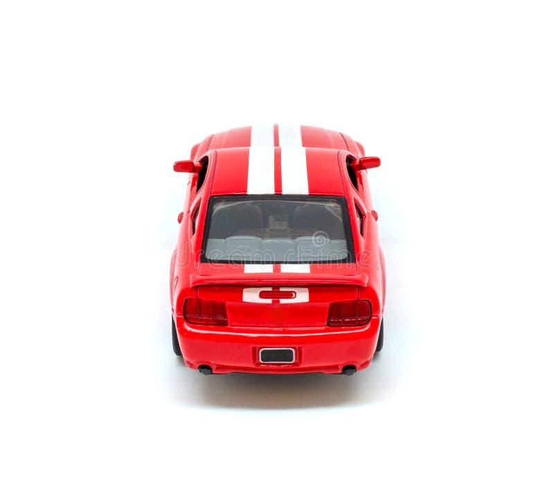 Foto del coche modelo del juguete rojo aislado en el fondo blanco fotos de archivo libres de regalías
