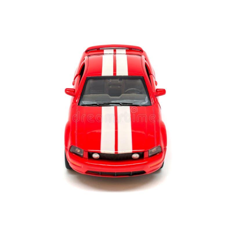 Foto del coche modelo del juguete rojo aislado en el fondo blanco imágenes de archivo libres de regalías