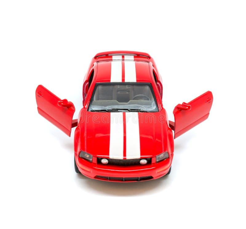 Foto del coche modelo del juguete rojo aislado en el fondo blanco imagen de archivo libre de regalías