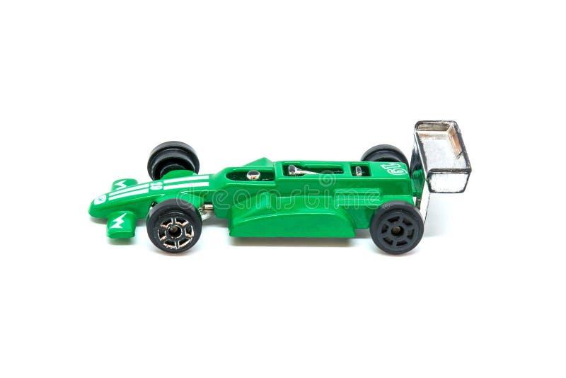 Foto del coche modelo del juguete verde aislado en el fondo blanco fotos de archivo libres de regalías