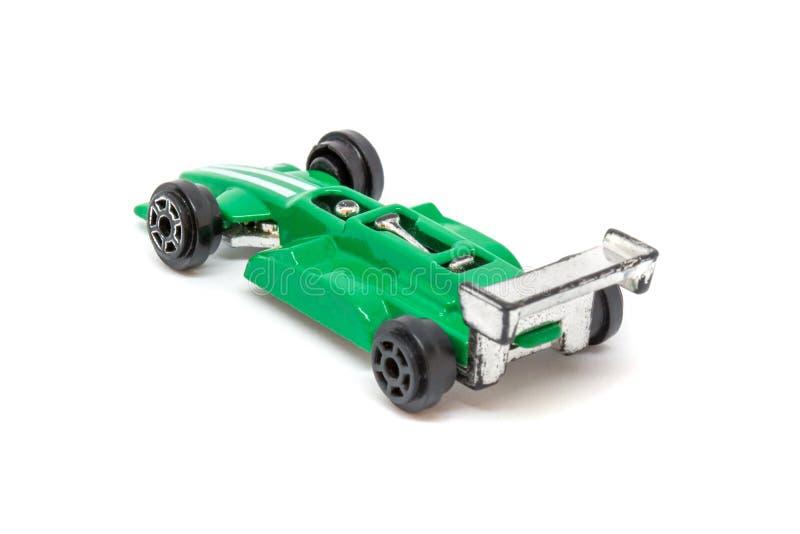 Foto del coche modelo del juguete verde aislado en el fondo blanco imagen de archivo libre de regalías