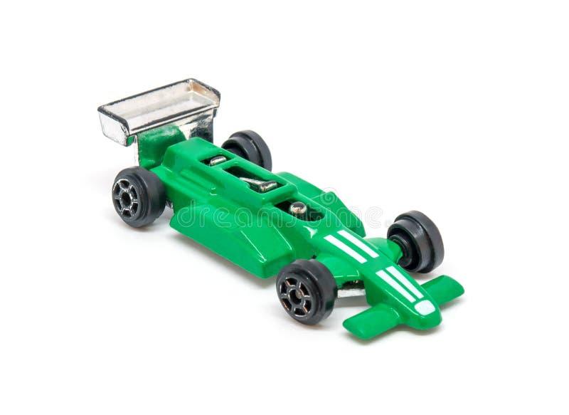 Foto del coche modelo del juguete verde aislado en el fondo blanco fotos de archivo